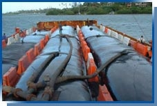 Geotubes being transported on a barge